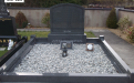 Gavins Memorials, Ballyhaunis, Co Mayo, Ireland.  Mid Grey Recessed Boulder - GM 025